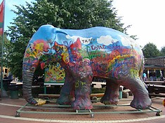 Rainbow elephant and other animals in the city zoo